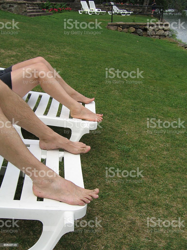 Couple Relaxing by the Lake royalty-free stock photo