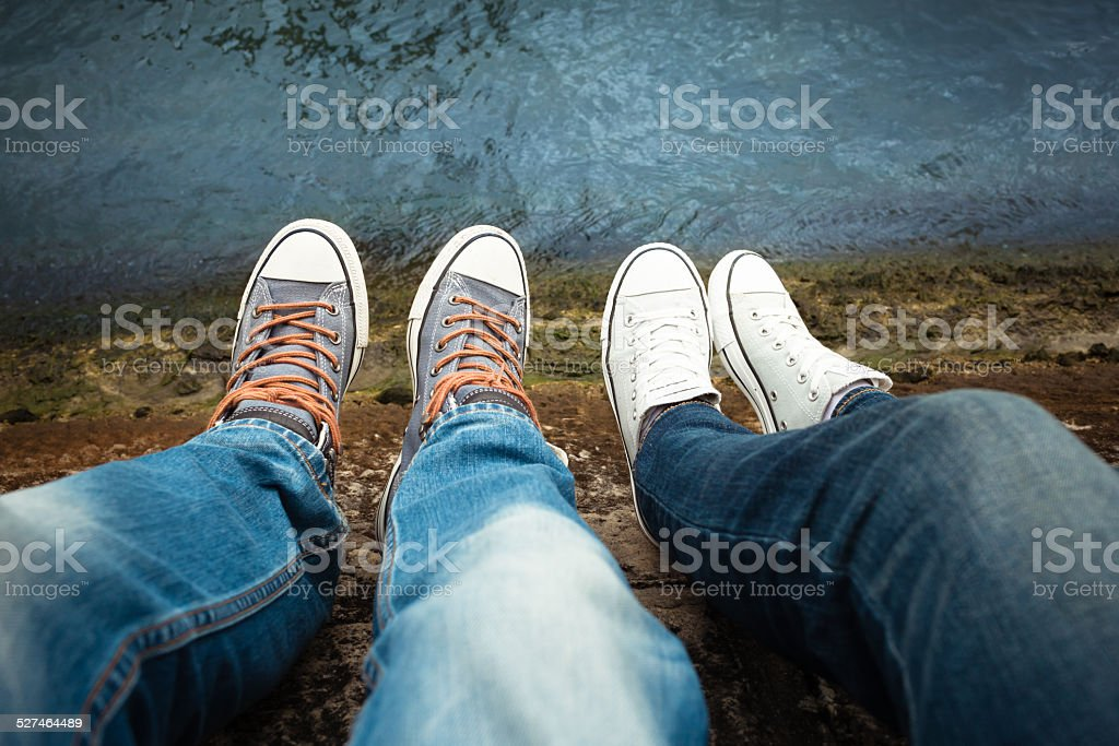 Couple relaxing by the river stock photo