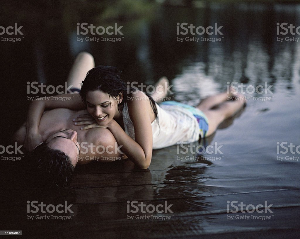 A couple relaxing by the water royalty-free stock photo