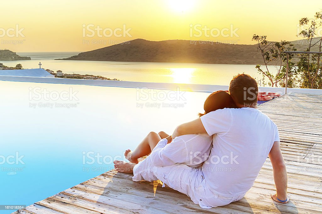 A couple relaxing by water in Crete stock photo