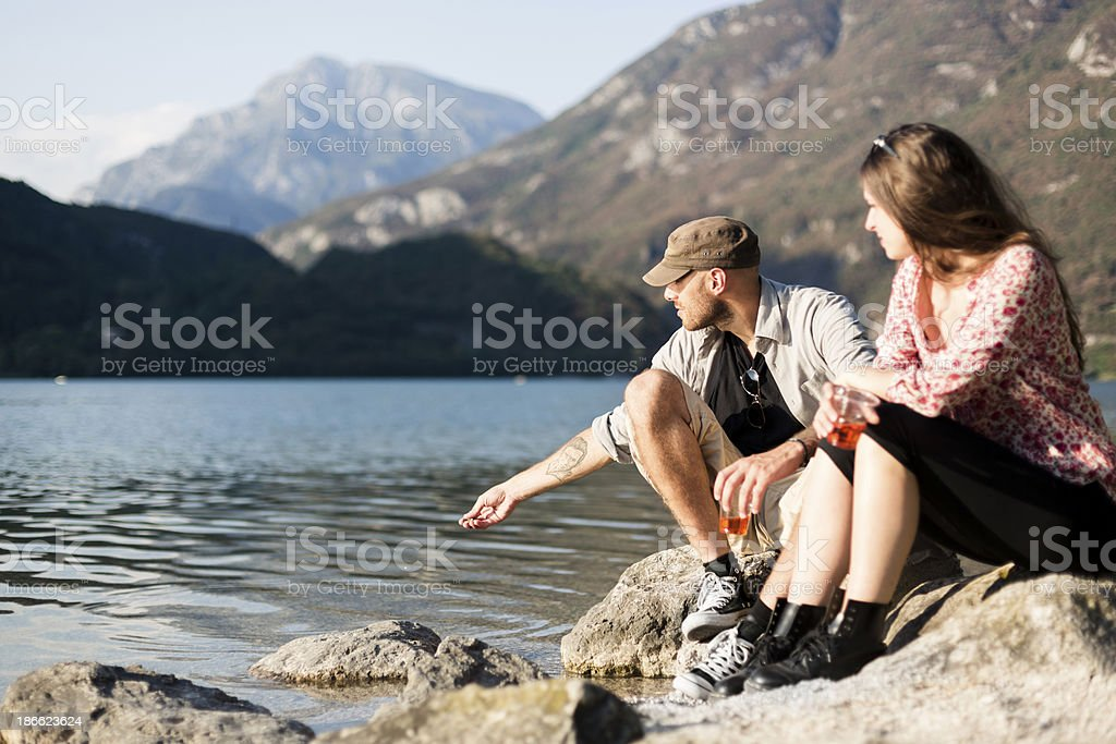 Couple relaxing during a sunny day on lake royalty-free stock photo