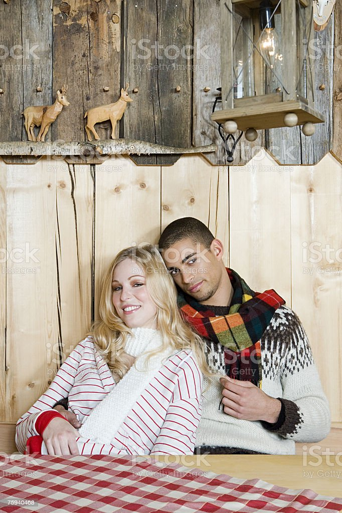 Couple relaxing in a log cabin royalty-free stock photo