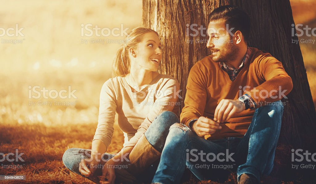 Couple relaxing in a park. stock photo