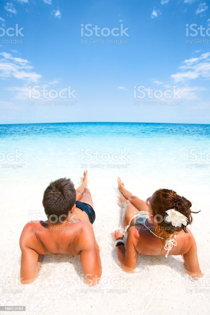 Couple relaxing in a water stock photo