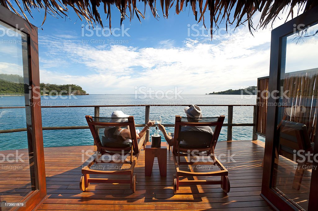 Couple relaxing in an over water bungalow royalty-free stock photo
