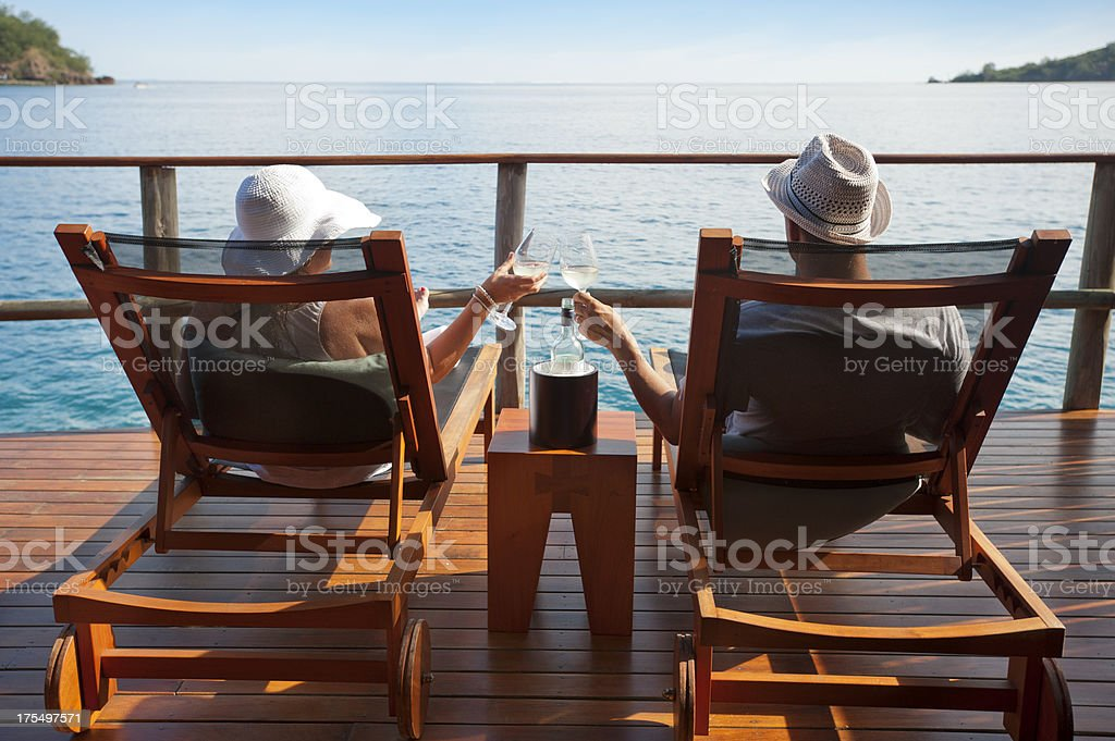 Couple relaxing in an over water bungalow stock photo