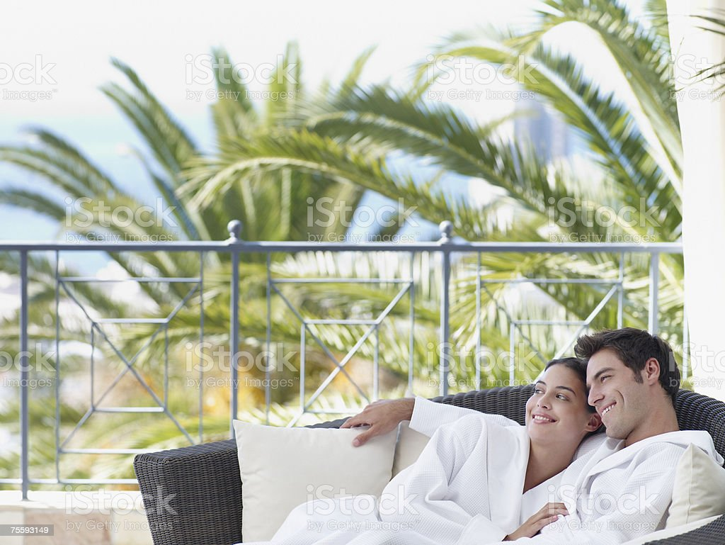 A couple relaxing in bathrobes royalty-free stock photo