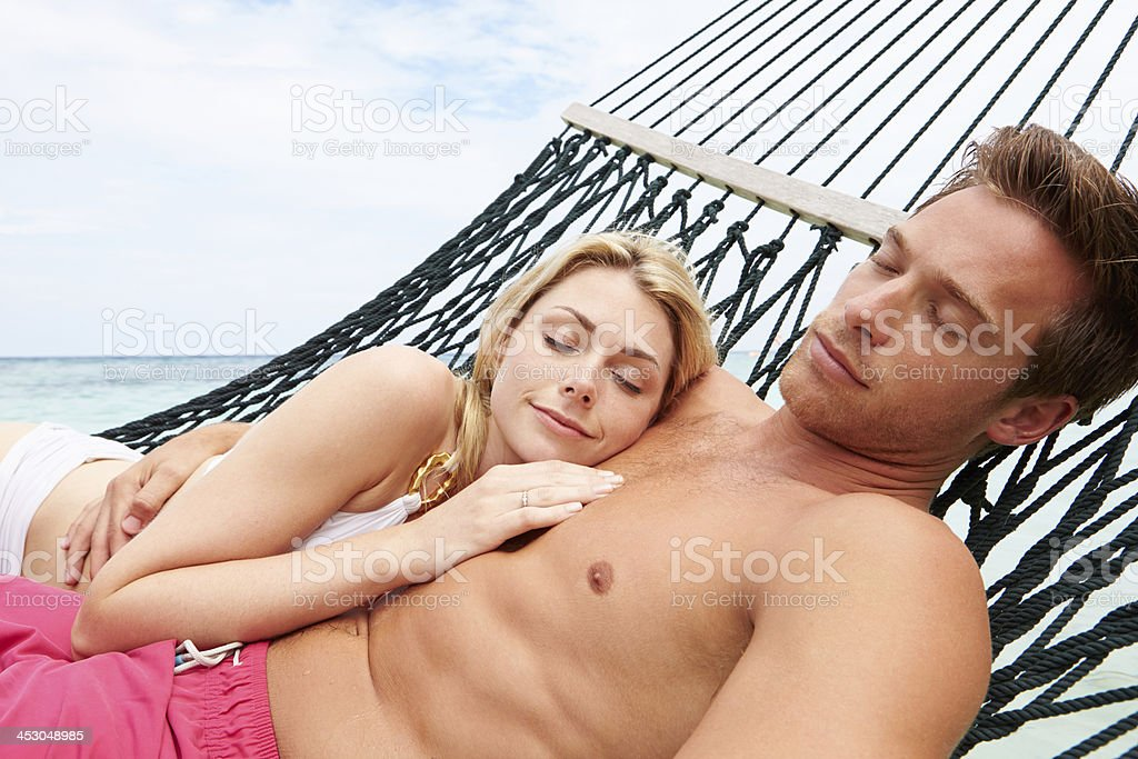 Couple Relaxing In Beach Hammock royalty-free stock photo