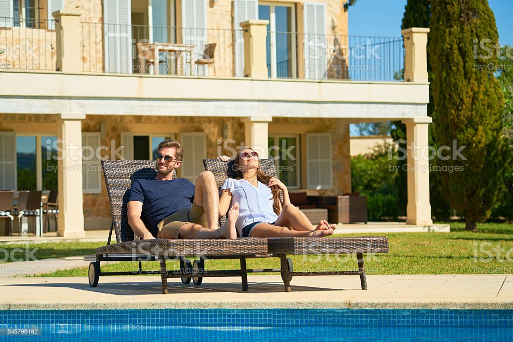 couple relaxing in garden of private country estate stock photo
