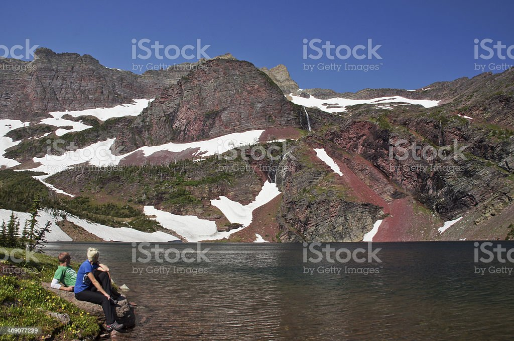 Couple Relaxing in Glacier National Park stock photo