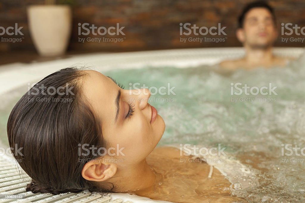 Couple relaxing in jacuzzi stock photo
