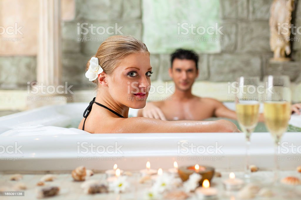 Couple relaxing in jacuzzi royalty-free stock photo