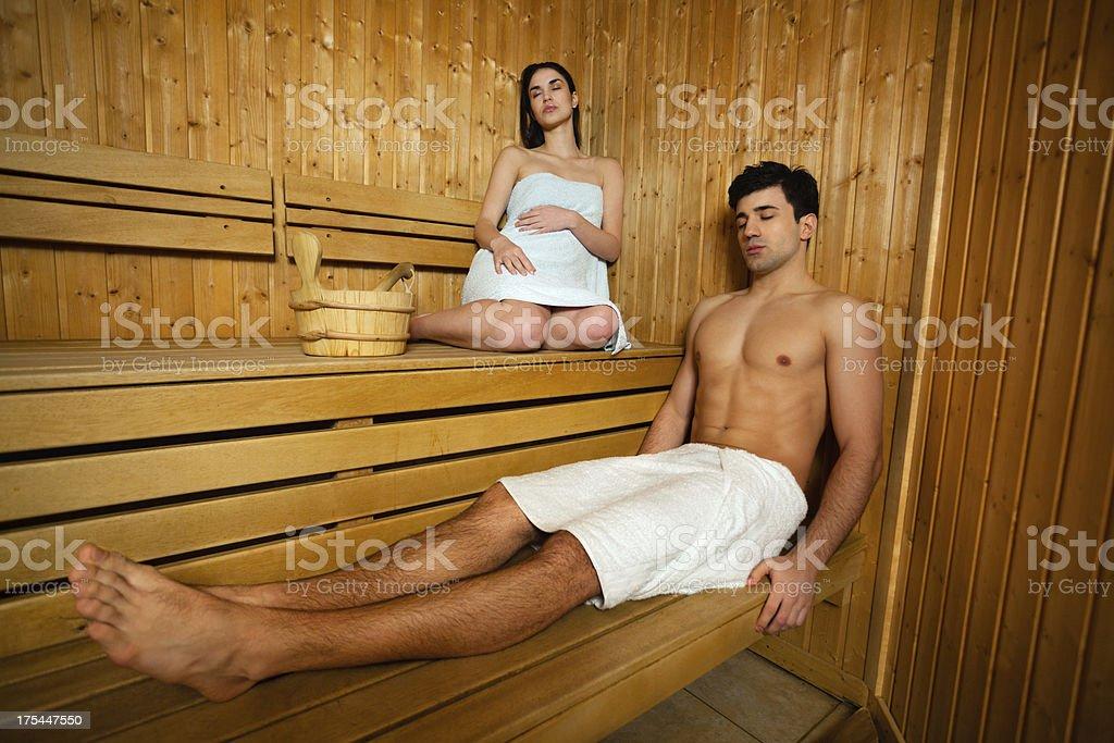 Couple relaxing in sauna stock photo
