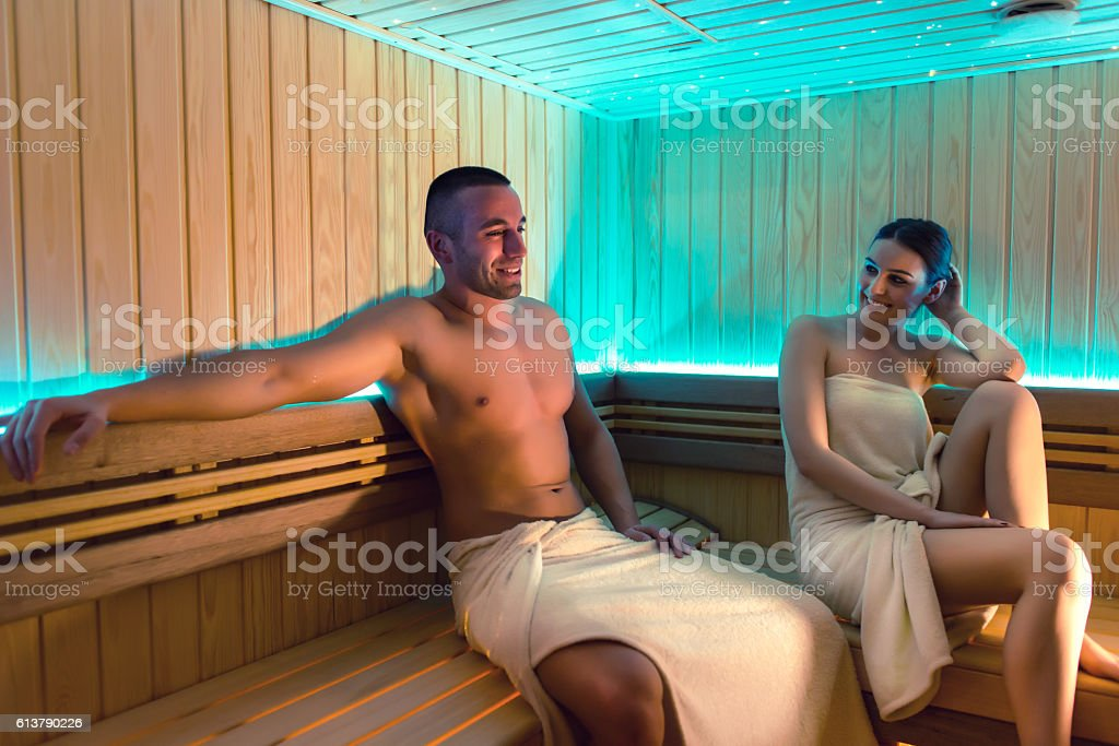 Couple relaxing in sauna stock photo