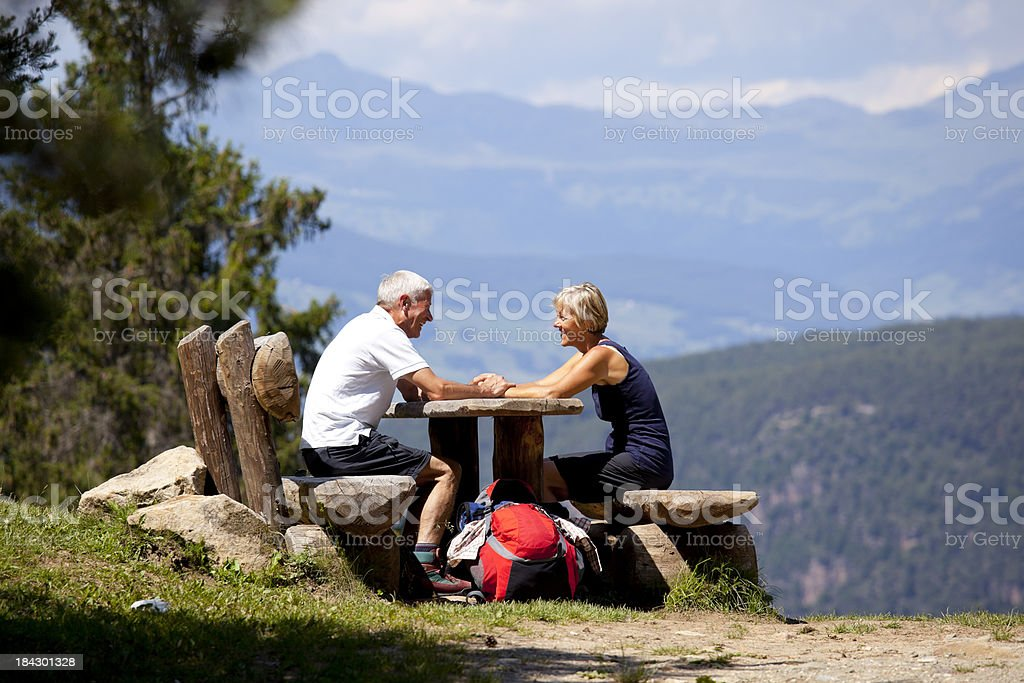 Couple relaxing in the mountains royalty-free stock photo