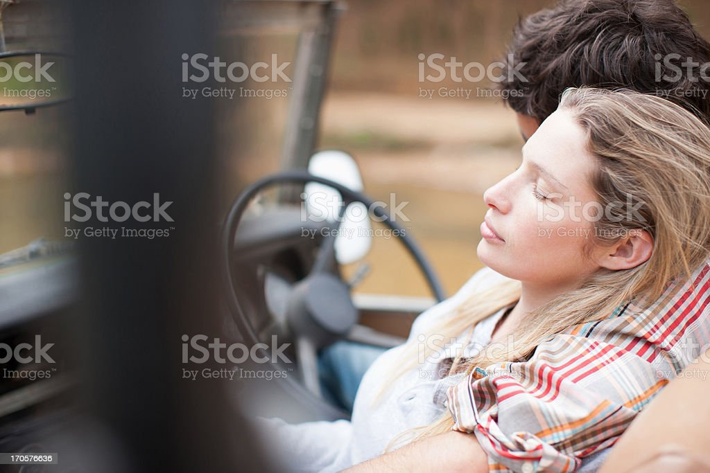 Couple relaxing  in vehicle  stock photo