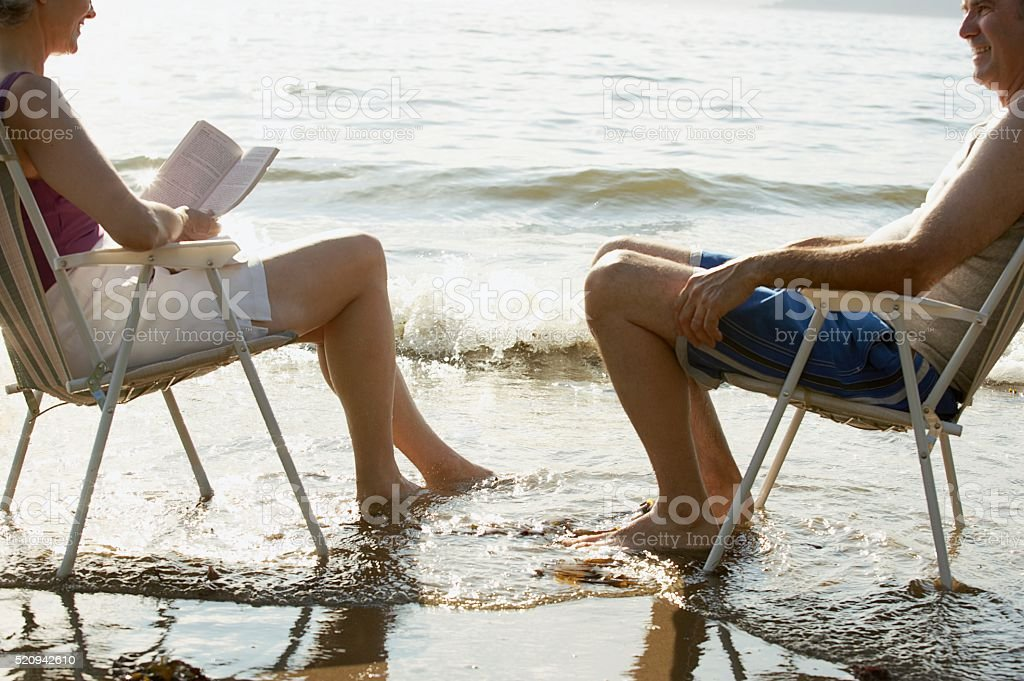 Couple relaxing on a beach stock photo