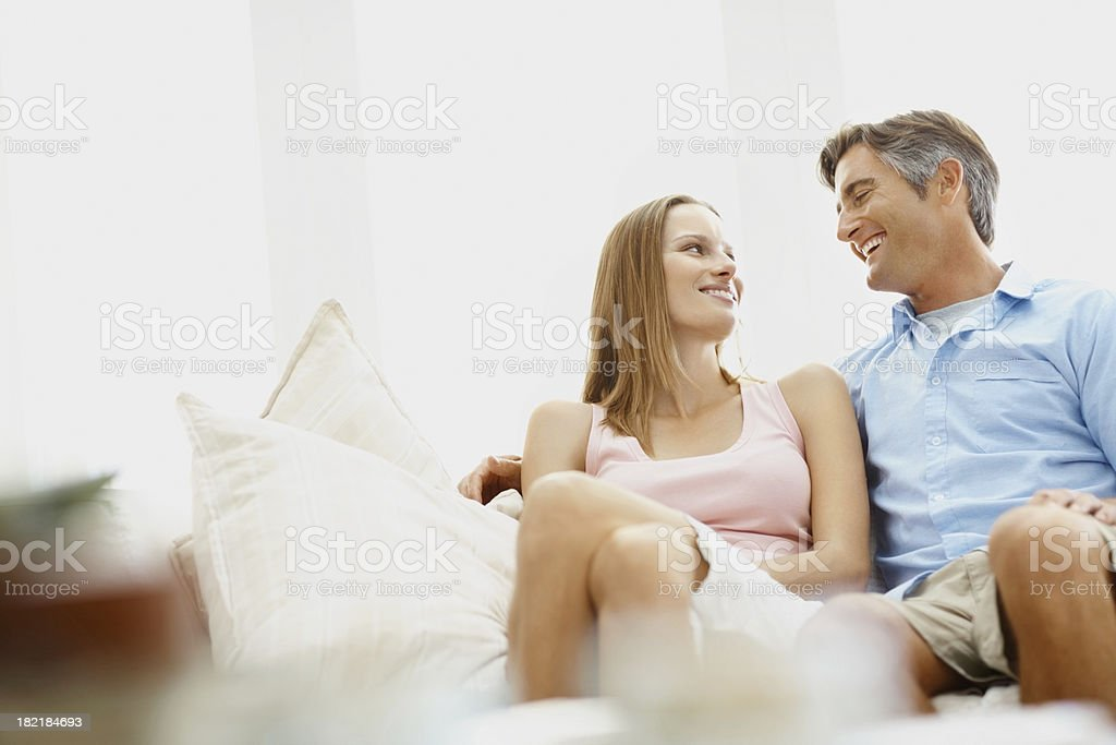 Couple relaxing on a couch royalty-free stock photo