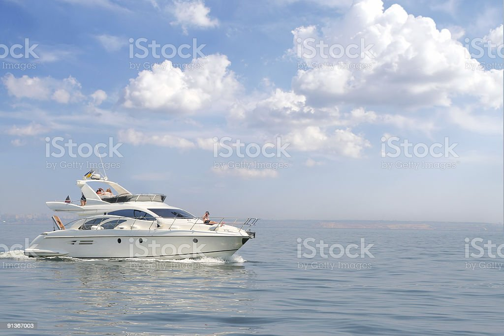 Couple relaxing on a yacht between the ocean royalty-free stock photo