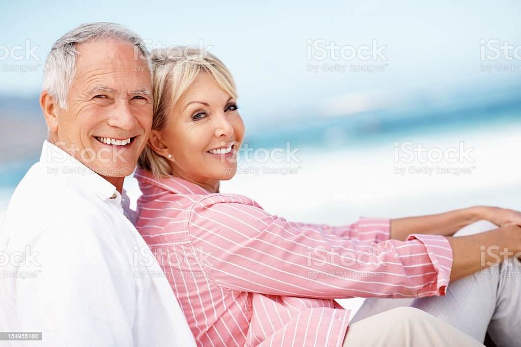Couple relaxing on beach royalty-free stock photo