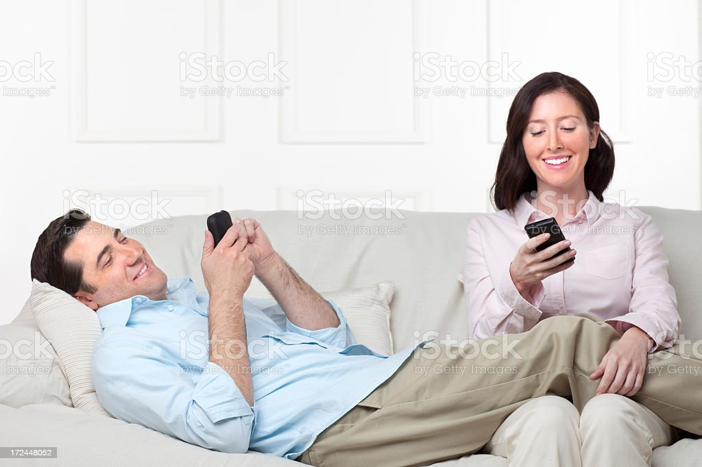 Couple Relaxing on Couch royalty-free stock photo