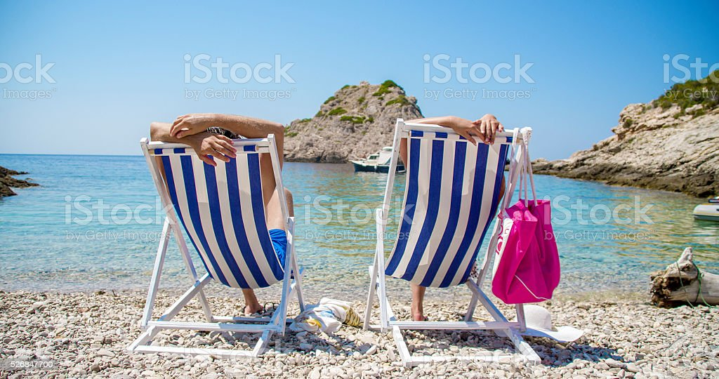 Couple relaxing on deck chairs at Vis island stock photo