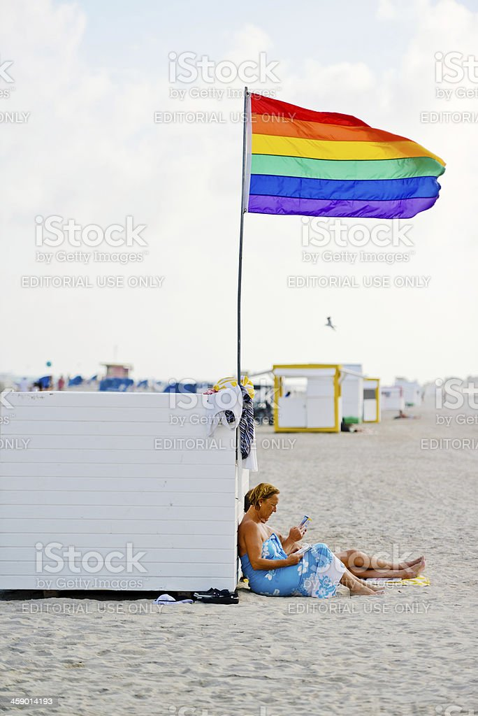 Couple relaxing on Gay Beach, USA royalty-free stock photo