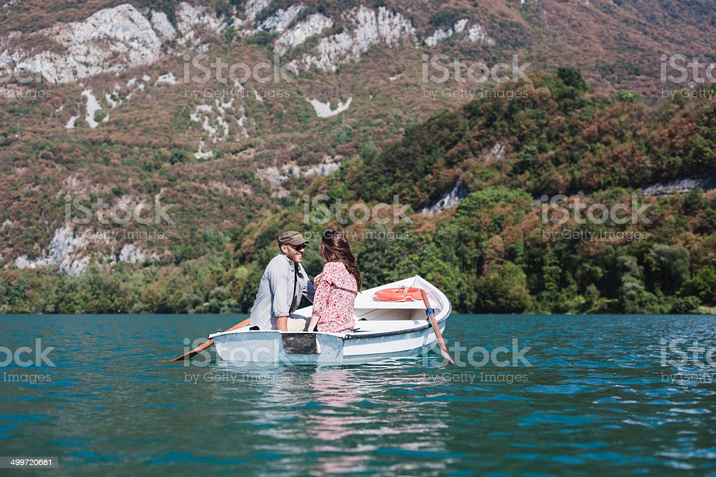 Couple relaxing on the boat royalty-free stock photo
