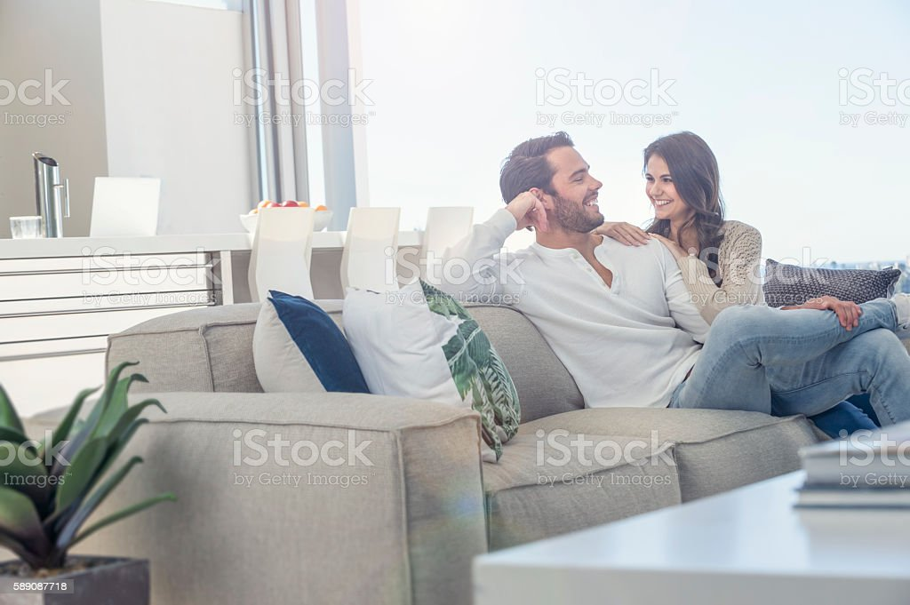 Couple relaxing on the sofa. stock photo