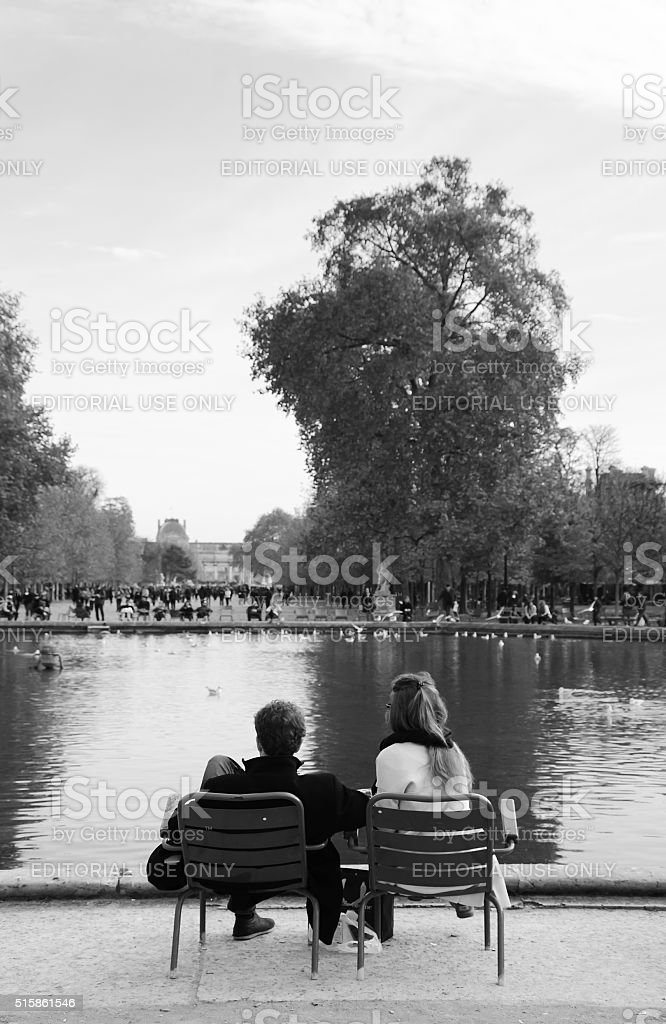 Couple relaxing Tuileries garden near Louvre museum stock photo