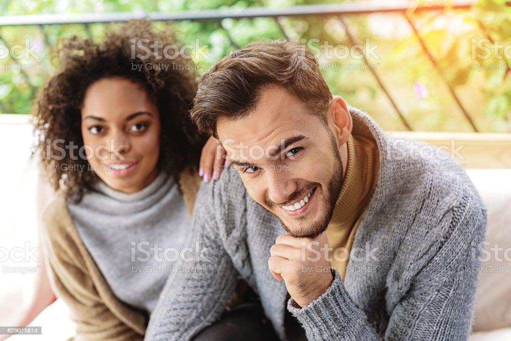 couple resting and looking into a camera stock photo