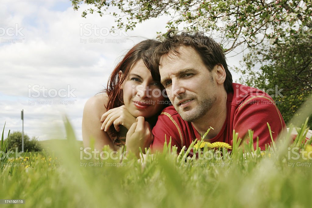 Couple resting on grass royalty-free stock photo
