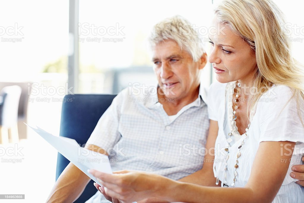Couple reviewing documents royalty-free stock photo