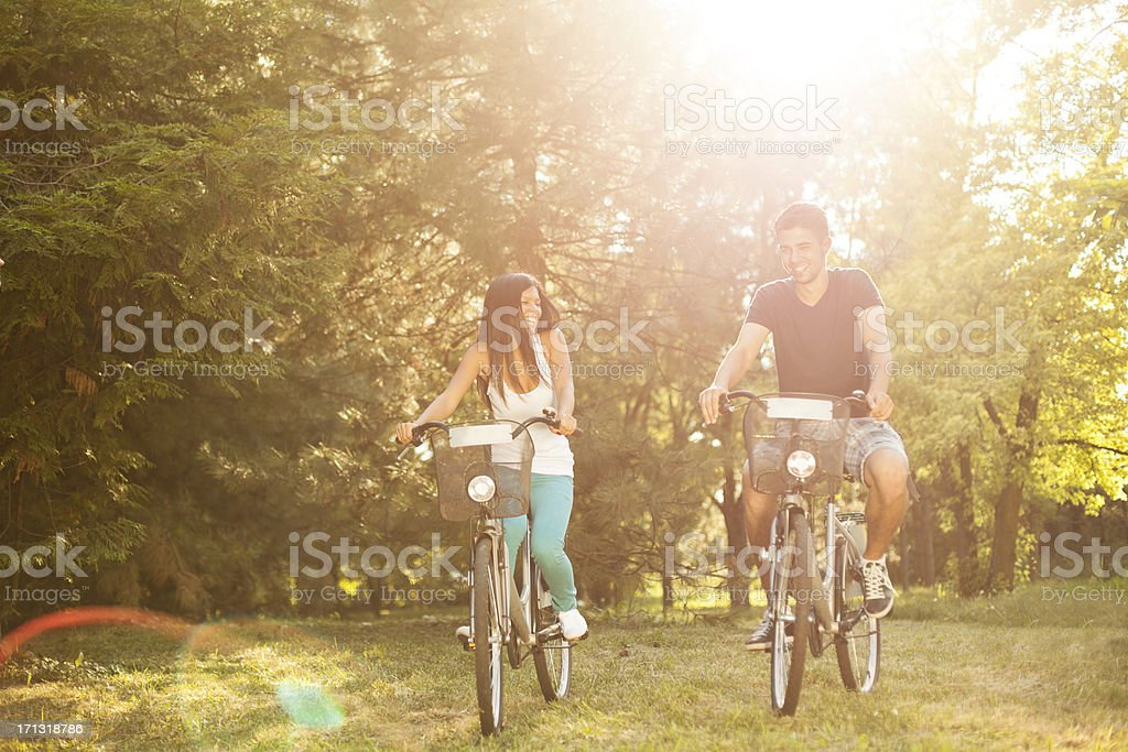 Couple riding bicycle royalty-free stock photo
