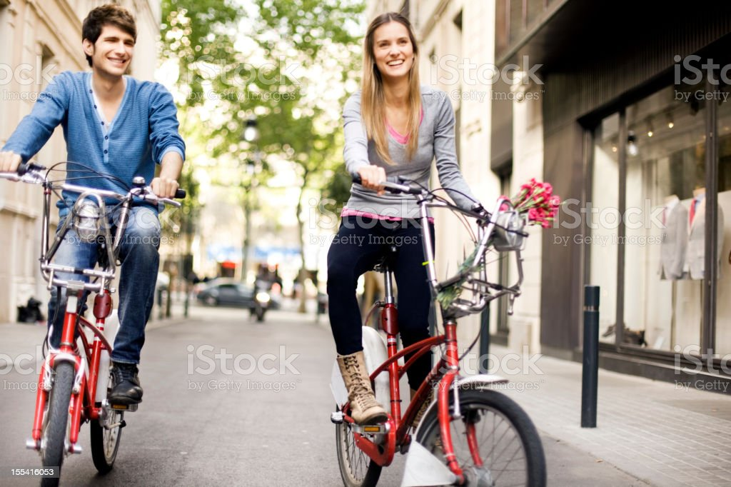 Couple riding bicycles in the city royalty-free stock photo
