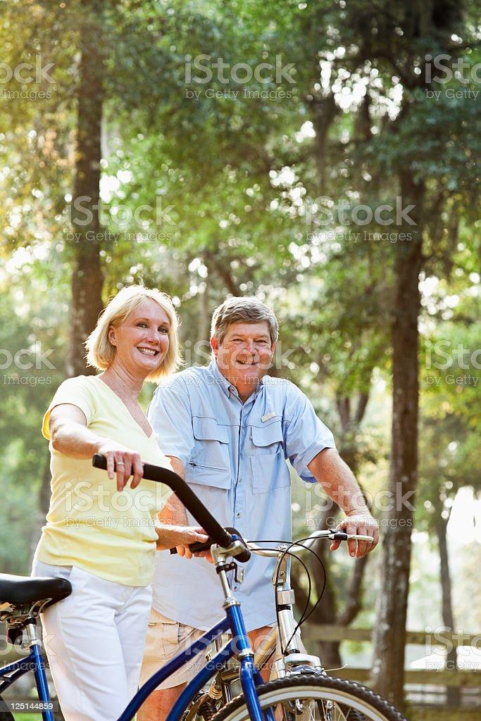 Couple riding bicycles stock photo