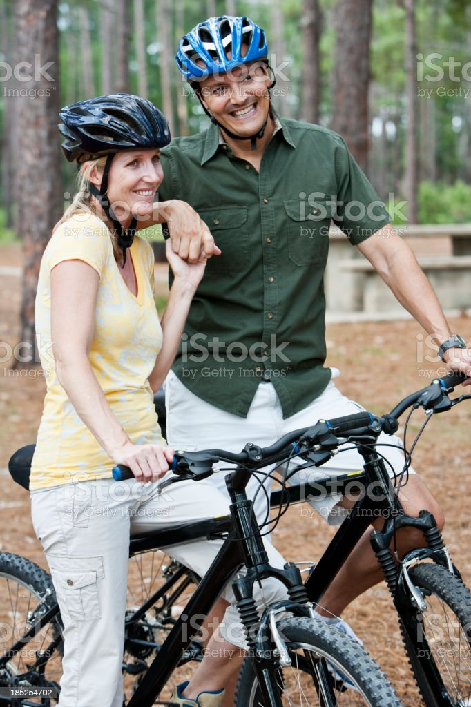 Couple riding bicycles stock photo