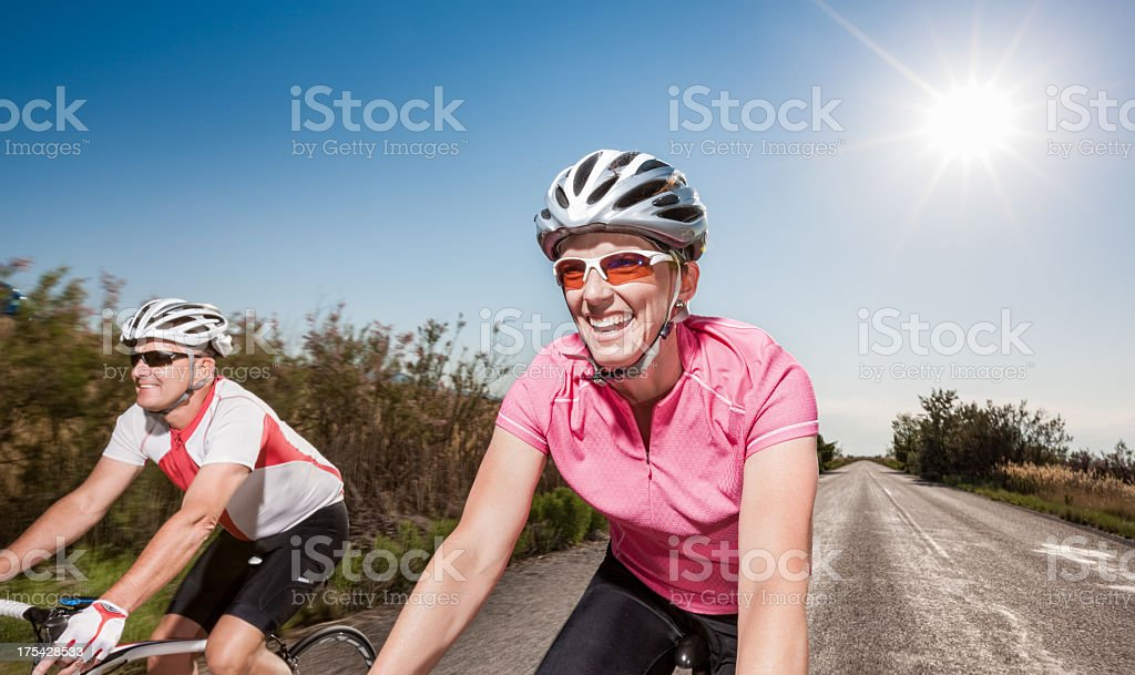 Couple Riding Bicycles Together royalty-free stock photo