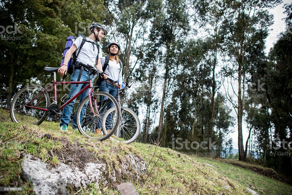 Couple riding bikes in the countryside stock photo