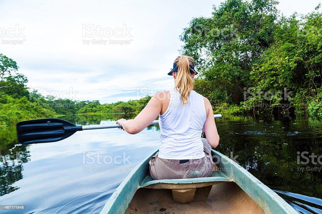 Couple riding canoe in Pantanal River, Brazil stock photo
