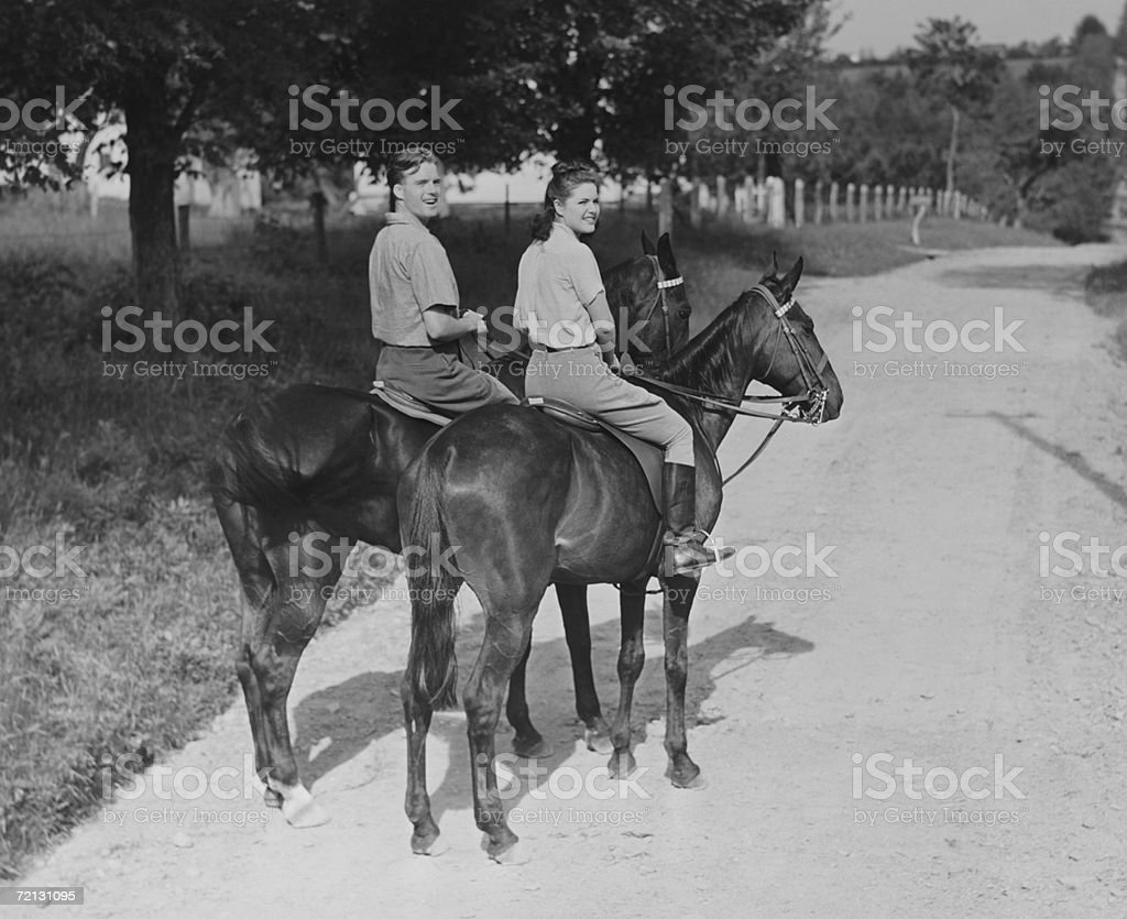 Couple riding horses (B&W),, portrait stock photo