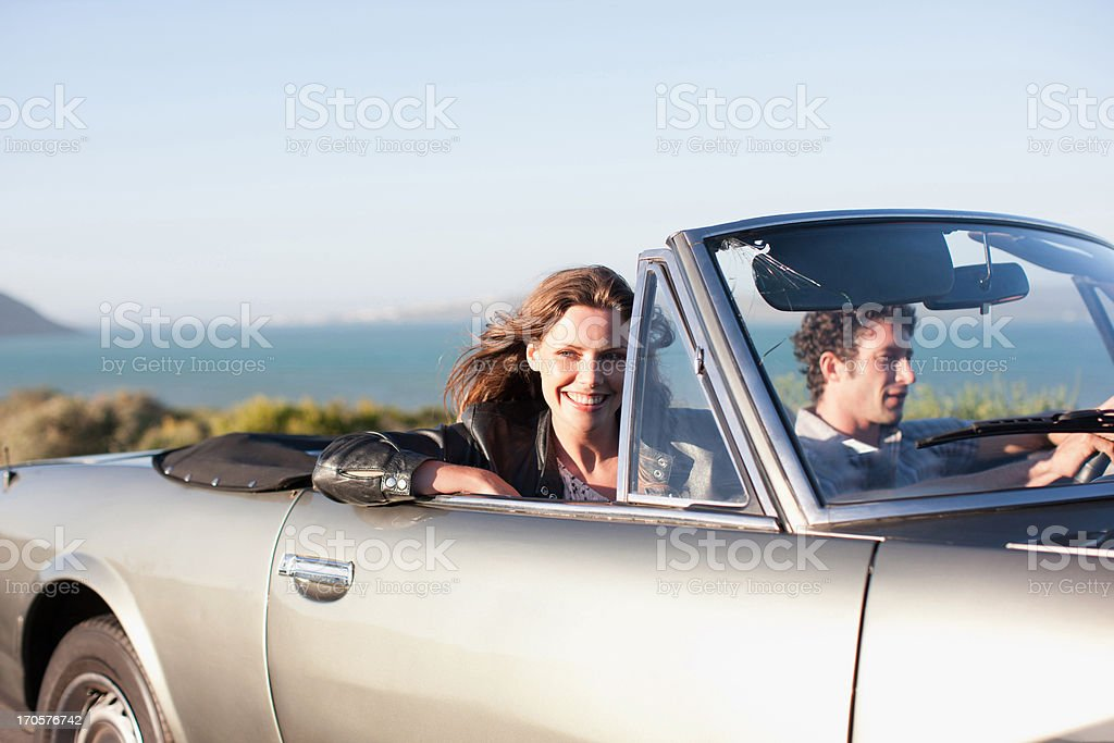 Couple riding in car  together stock photo