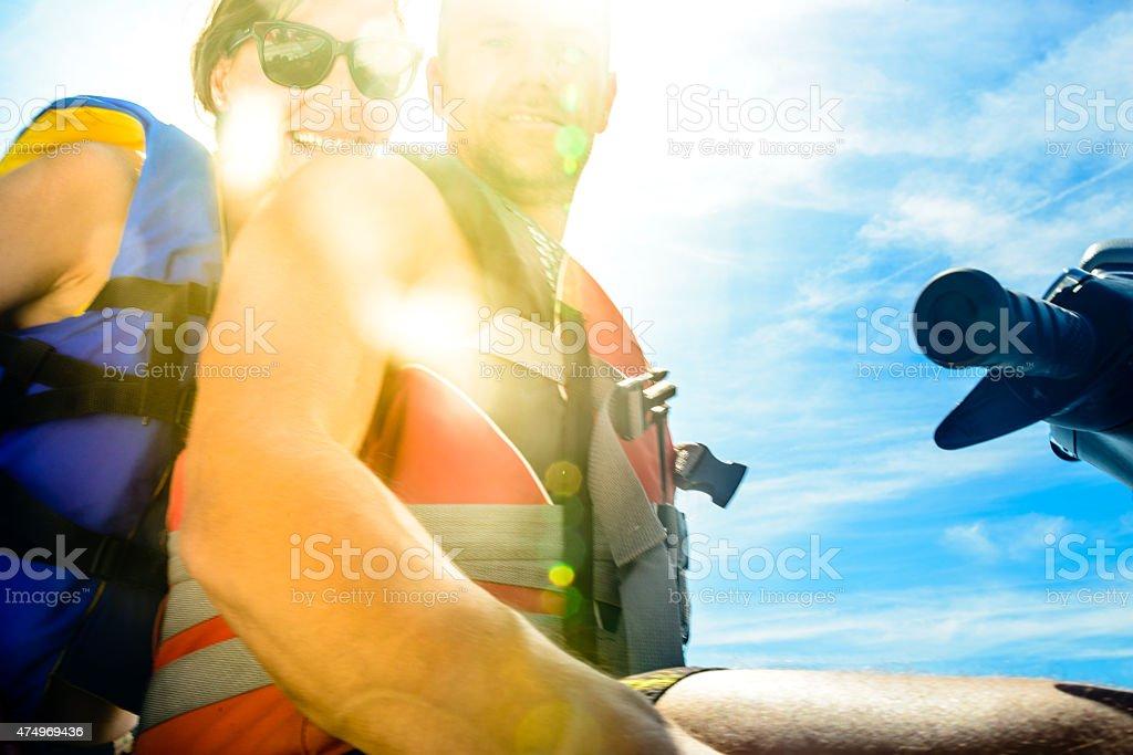 Couple Riding  Jet Boat stock photo