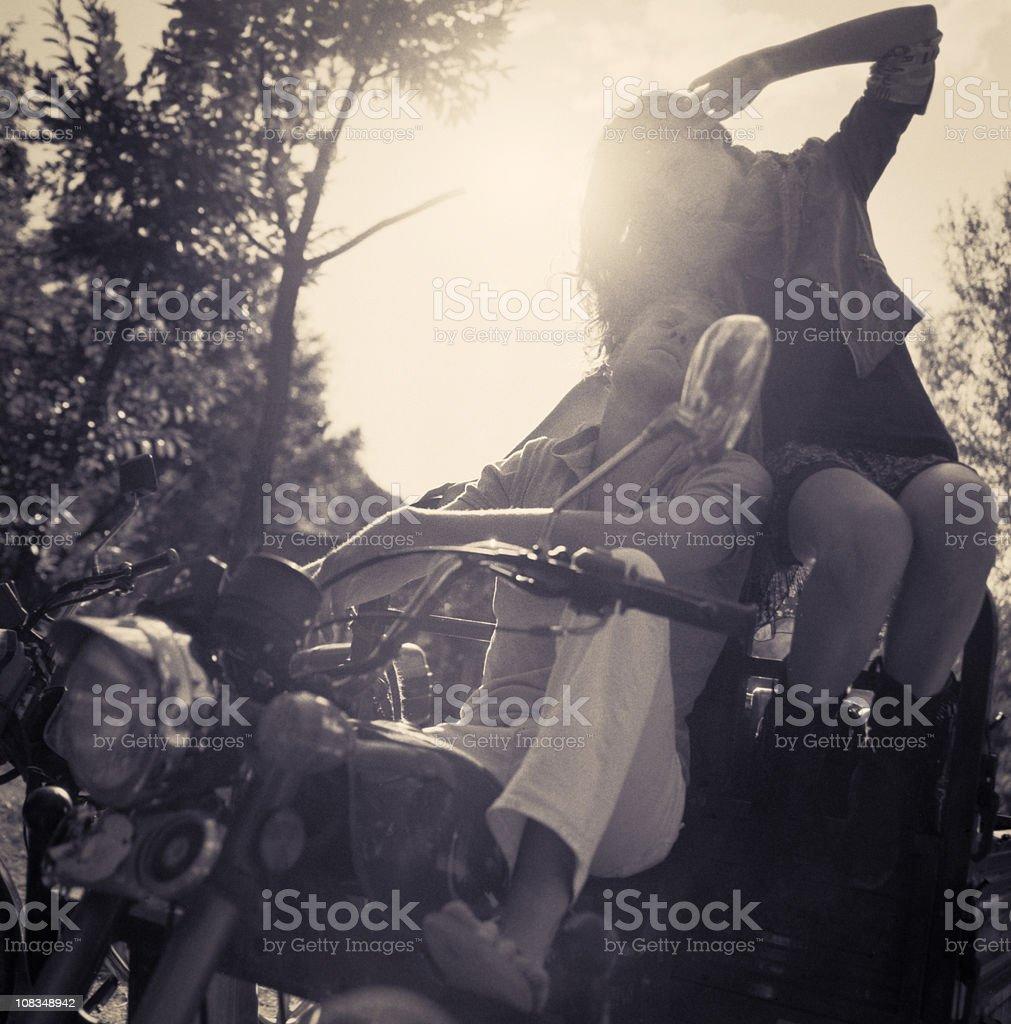 Couple riding motorbike stock photo