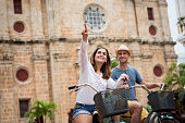 Couple riding on bikes in Cartagena