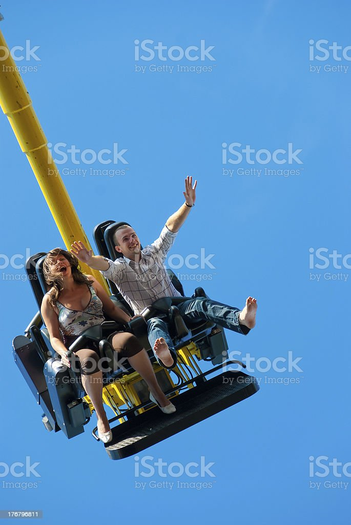 Couple riding on the attraction stock photo