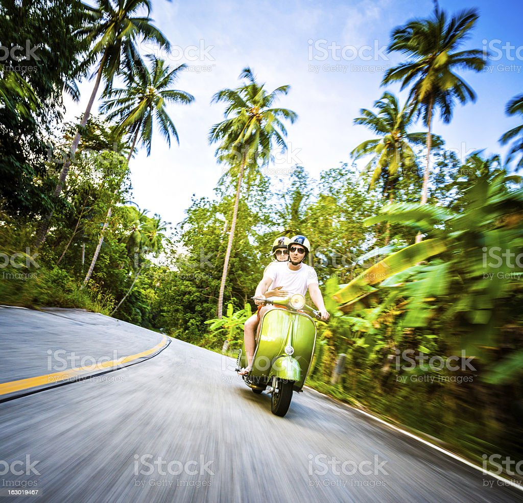 Couple riding retro bike royalty-free stock photo