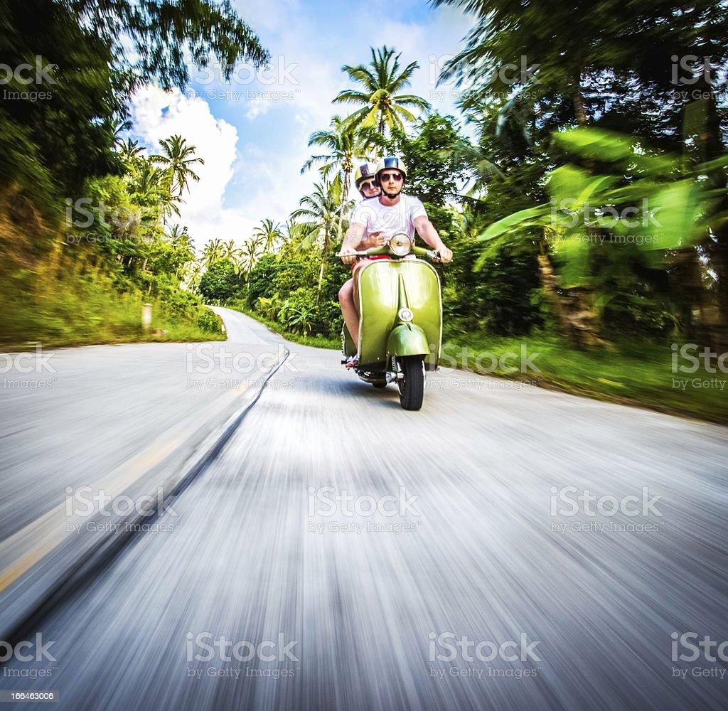 Couple riding retro bike stock photo