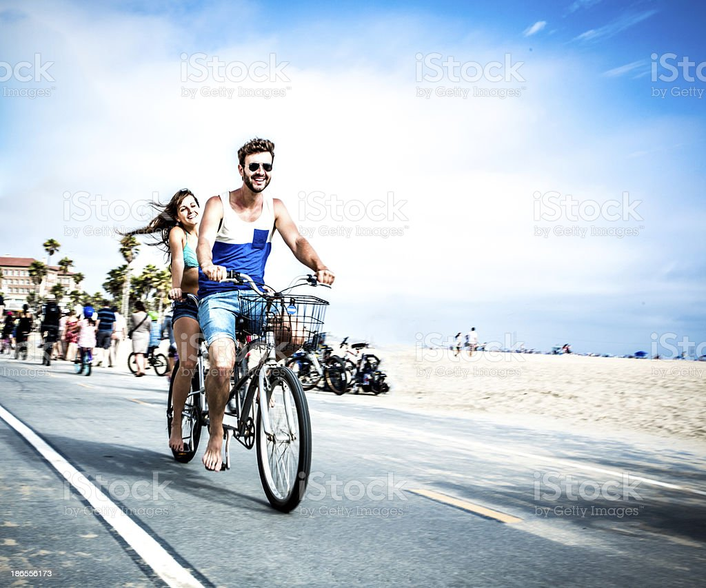 Couple riding tandem bicycle in LA stock photo