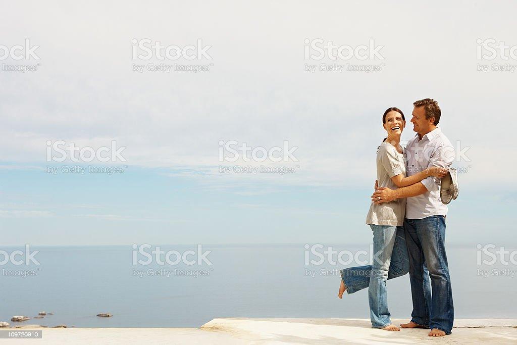 Couple romancing at beach royalty-free stock photo